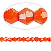 Bead, Celestial Crystal®, glass, 16-facet, opaque orange, 4mm faceted bicone. Sold per 16-inch strand.