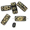 Bead, glass, opaque black and gold color, 22x10mm-24x10mm rectangle with assorted designs. Sold per pkg of 6.