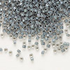 Seed bead, Delica®, glass, color-lined dark smoke, (DB81), #11 round. Sold per 7.5-gram pkg.