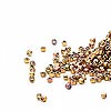 Seed bead, Delica®, glass, opaque 24Kt gold-finished rainbow rose, (DB501CUT), #11 cut. Sold per pkg of 50 grams.