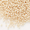 Seed bead, Delica®, glass, opaque luster light beige, (DB204), #11 round. Sold per pkg of 50 grams.