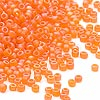 Seed bead, Dyna-Mites™, glass, frosted orange AB, #11 round. Sold per 1/2 kilogram pkg.