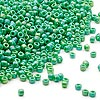 Seed bead, Dyna-Mites™, glass, opaque rainbow emerald green, #11 round. Sold per 1/2 kilogram pkg.