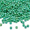 Seed bead, Dyna-Mites™, glass, rainbow opaque jade green, #8 round. Sold per 40-gram pkg.