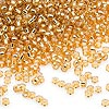 Seed bead, Dyna-Mites™, glass, silver-lined gold, #11 round. Sold per 40-gram pkg.