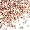 Seed bead, Dyna-Mites™, glass, silver-lined rainbow light pink, #11 round with square hole. Sold per 1/2 kilogram pkg.