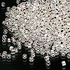 Seed bead, Dyna-Mites™, glass, silver-lined rainbow silver, #11 round with square hole. Sold per 1/2 kilogram pkg.