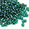 Seed bead, Dyna-Mites™, glass, transparent rainbow emerald green, #6 round. Sold per 1/2 kilogram pkg.