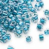 Seed bead, Miyuki, glass, clear color-lined dark blue, (TR1115), #5 triangle. Sold per 250-gram pkg.