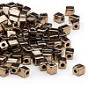 Seed bead, Miyuki, glass, opaque metallic dark gold, (#SB457), 3.5-3.7mm square. Sold per 250-gram pkg.