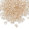 Seed bead, Preciosa Twin™, glass, crystal honey, 5x2.5mm oval with 2 holes. Sold per 50-gram pkg.