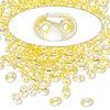 Seed bead, Preciosa® Twin™, glass, yellow-lined clear terra, 5x2.5mm oval with 2 holes. Sold per 10-gram pkg.