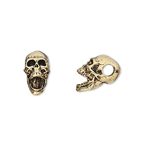 bead, antique gold-plated pewter (tin-based alloy), 14x10mm skull with 3.5mm hole. sold per pkg of 2.