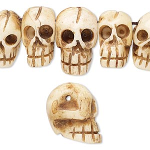 bead, bone (dyed), antiqued, 11x6mm-24x15mm graduated hand-carved top-drilled carved skull, mohs hardness 2-1/2. sold per pkg of 15.