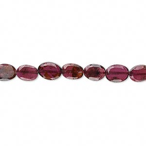 bead, garnet (dyed), 6x5mm-7x5mm faceted oval, b- grade, mohs hardness 7 to 7-1/2. sold per 15-inch strand.