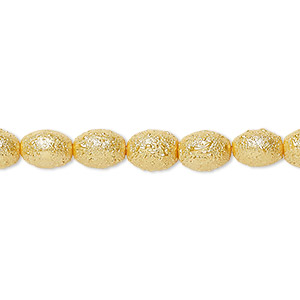 bead, glass pearl, golden rod, 7x6mm textured barrel. sold per pkg of (2) 16-inch strands.