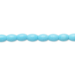 bead, magnesite (dyed / stabilized), blue, 6x4mm-7x5mm oval, c grade, mohs hardness 3-1/2 to 4. sold per 15-inch strand.