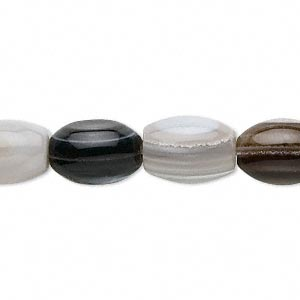 bead, striped agate (dyed), 12x9mm-14x10mm oval, b grade, mohs hardness 6-1/2 to 7. sold per 15-inch strand.