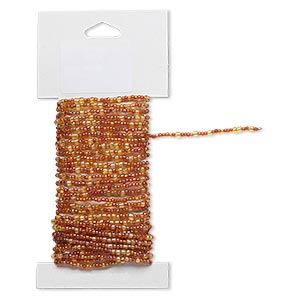 beaded wire, glass and brass, transparent rainbow gold and orange, #9 and #6 round seed beads. sold per 15-foot card with hanging tab.