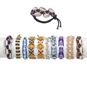 bracelet mix, wood (dyed) / gold-ringer cowrie shell (natural) / nylon cord / polymer clay / plastic / glass, multicolored, promise style, adjustable from 6-9 inches with macrame knot closure. sold per pkg of 10.