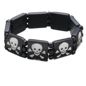 bracelet, stretch, bone (dyed) and glass, black and white, 4mm round and 16x16mm flat square with skull and crossbones design, 7 inches. sold individually.
