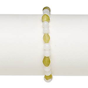 bracelet, stretch, olive new jade (natural) and acrylic, white, 5mm round and 8x6mm-9x7mm oval, 7 inches. sold individually.