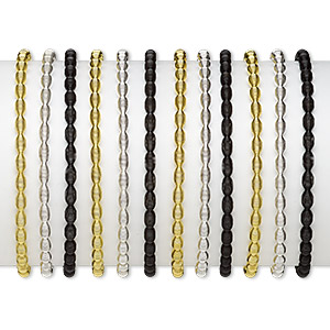 bracelet, stretch, steel / gold-finished steel / silver-plated steel, black, 4mm wide with oval design, 7 inches. sold per pkg of 12.