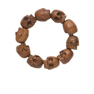 bracelet, stretch, wood (natural), 18x16mm hand-carved skull, 6-1/2 inches. sold individually.