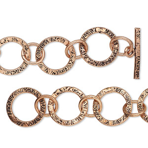 chain, antiqued copper, 15mm textured round link, 36 inches with toggle clasp. sold individually.