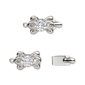 clasp, tab, cubic zirconia and rhodium-plated brass, clear, 13x9mm bow. sold individually.