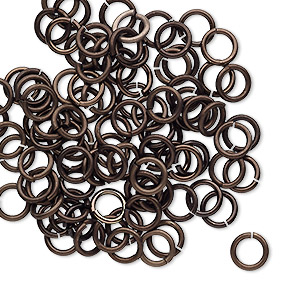 jumpring, anodized tempered aluminum, brown, 6mm round, 4.2mm inside diameter, 18 gauge. sold per pkg of 100.