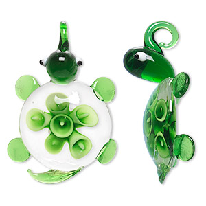 pendant, lampworked glass, green / white / black, 50x32mm single-sided turtle with flower. sold individually.