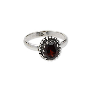 ring, antiqued sterling silver and garnet (natural), 9x7mm faceted oval, size 8. sold individually.