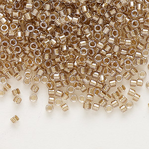 seed bead, delica, glass, color-lined champagne, (db907), #11 round. sold per 50-gram pkg.