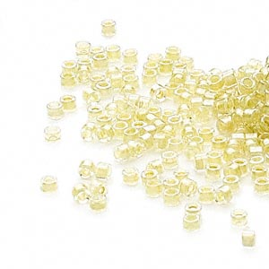 seed bead, delica, glass, color-lined light chartreuse, (db910), #11 round. sold per 50-gram pkg.