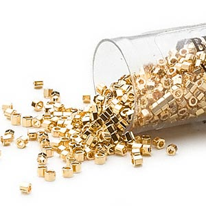 seed bead, delica, glass, opaque bright 24kt gold-finished, (db31cut), #11 cut. sold per 4-gram pkg.