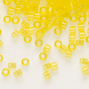 seed bead, delica, glass, transparent light yellow, (db1301), #11 round. sold per 7.5-gram pkg.