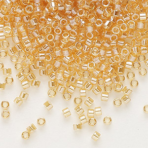 seed bead, delica, glass, transparent luster light amber yellow, (db99), #11 round. sold per 50-gram pkg.