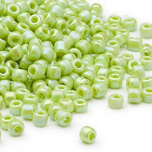 seed bead, dyna-mites™, glass, opaque rainbow light green, #6 round. sold per 40-gram pkg.