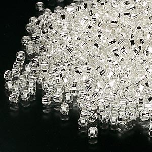 seed bead, dyna-mites™, glass, silver-lined translucent clear, #11 round with square hole. sold per 40-gram pkg.
