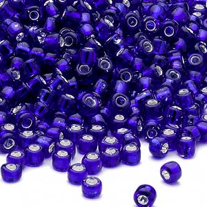 seed bead, dyna-mites™, glass, silver-lined translucent cobalt, #6 round. sold per 1/2 kilogram pkg.