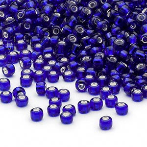 seed bead, dyna-mites™, glass, silver-lined translucent cobalt, #8 round. sold per 40-gram pkg.