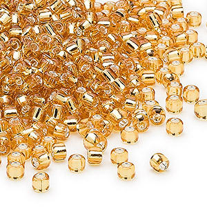 seed bead, dyna-mites™, glass, silver-lined translucent gold, #8 round. sold per 1/2 kilogram pkg.