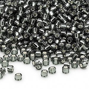 seed bead, dyna-mites™, glass, silver-lined translucent gunmetal, #8 round. sold per 1/2 kilogram pkg.