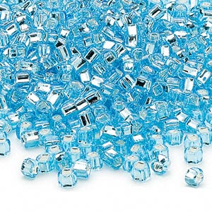 seed bead, dyna-mites™, glass, silver-lined translucent light aqua, #6 round with square hole. sold per 40-gram pkg.