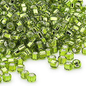 seed bead, dyna-mites™, glass, silver-lined translucent light green, #6 round with square hole. sold per 1/2 kilogram pkg.