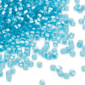 seed bead, dyna-mites™, glass, silver-lined translucent matte aqua, #11 round with square hole. sold per 40-gram pkg.