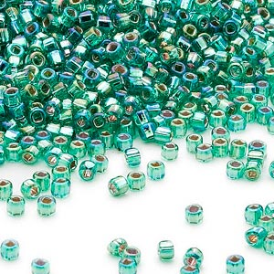 seed bead, dyna-mites™, glass, silver-lined translucent rainbow jade green, #11 round with square hole. sold per 40-gram pkg.