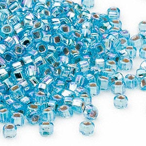 seed bead, dyna-mites™, glass, silver-lined translucent rainbow light aqua, #6 round with square hole. sold per 40-gram pkg.