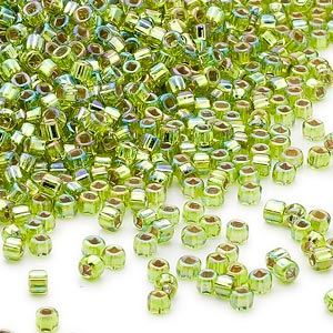 seed bead, dyna-mites™, glass, silver-lined translucent rainbow light green, #11 round with square hole. sold per 1/2 kilogram pkg.